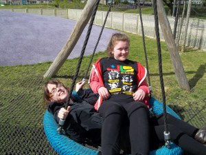 My sister and I on the swing